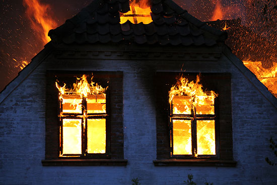 House-on-fire-which-will-be-in-need-of-fire-damage-restoration
